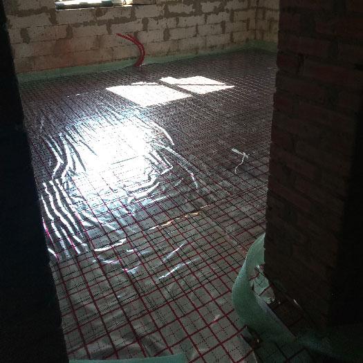 Монтаж радиаторов отопления Purmo и системы водяной теплого пола в коттедже